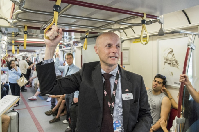 Andy Byford, the chief executive of the Toronto Transit Commission, rides on a so-called open gangway train in Toronto.